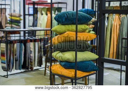 colored pillows folded in the textile store for decoration