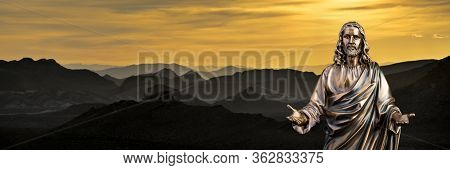 A Bronze Statue Of A Jesus Christ With A Sunset Background With Jagged Hills