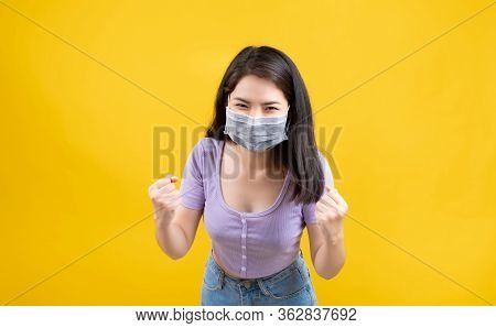 Studio Shot Portrait Asian Woman Wearing Mask Protection Against Germs From Coronavirus And Prevent