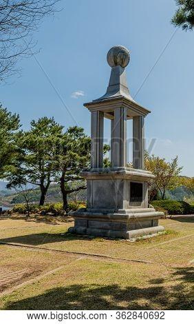 Jinan, South Korea; April 21, 2020: Tall Concrete Monument In Plaza Of Public Park Under Clear Blue