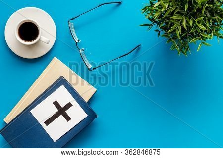 Holy Bible Book With Catholic Cross - Catholicism Religion Concept - On Blue Background Top View. Co