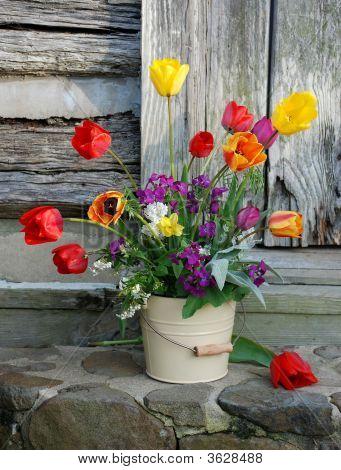 Homegrown Flower Arrangement in Bucket on Stone Steps