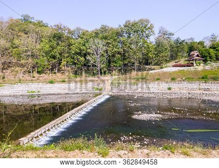 Small Irrigation Dam For Water Slowing After Flowing From The Large Dam, Distributed To The Cultivat