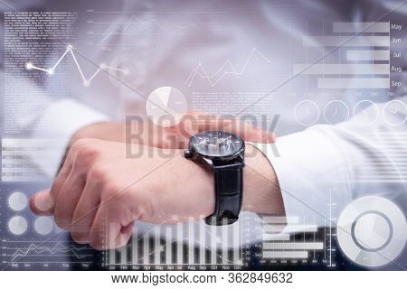 Man Checking Time With Wristwatch And Virtual Statistic Graphics. Caucasian Executive Waiting For Cl