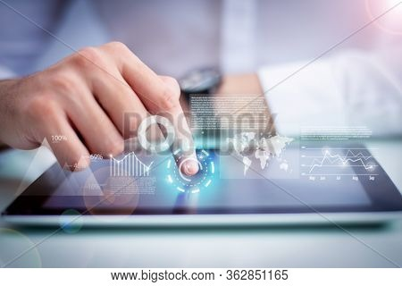 Closeup Of Person Touching Tablet And Virtual Statistic Graphics. Man Browsing On Digital Device. Te