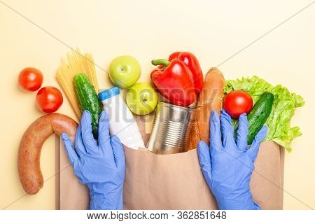 Fresh Vegetables, Baguette And Other Products In Paper Bag And Hands In Medical Gloves. Delivery Ser