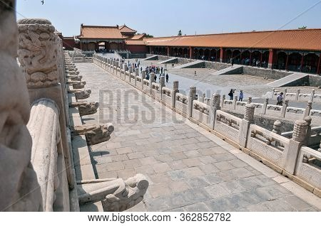 Beijing, China - May 24 2013: Tourists Walk In The Forbidden City Palace Complex. This Palace Museum