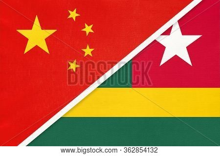 China Or Prc Vs Togo National Flag From Textile. Relationship Between Asian And African Countries.