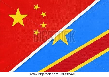 China Or Prc Vs Congo National Flag From Textile. Relationship Between Asian And African Countries.