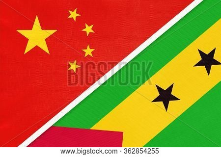 China Or Prc Vs Saint Thomas And Prince National Flag From Textile. Relationship Between Asian And A