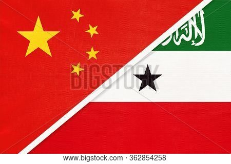 China Or Prc Vs Somaliland National Flag From Textile. Relationship Between Asian And African Countr
