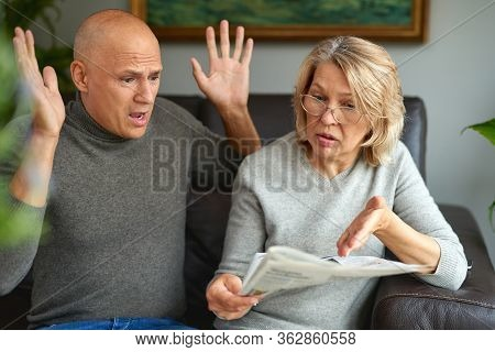 Adult Woman And Man Reading Newspaper.news, Press, Media, Holidays And People Concept .bad News.