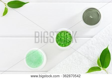 Natural Cosmetics Or Spa Products: Cosmetic Clay, Sea Salt And Scrub On A White Wooden Background. F