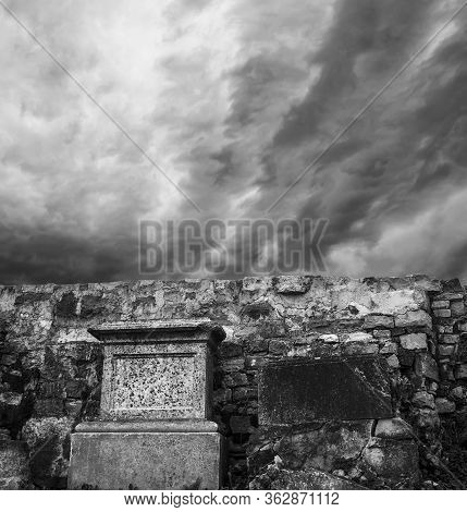 Gravestones With Some Dramatic Clouds Scene Behind