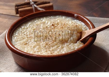 Rice Pudding With Cinnamon In A Clay Bowl