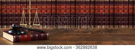 Justice Scales And Legal Law Book Near Mallet