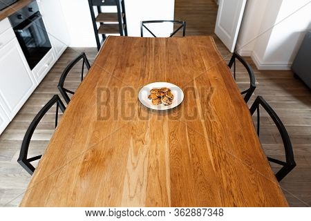 Lonely White Plate With Cookies On An Empty Dinner Table. Big Wooden Table With Chairs And Cookies I