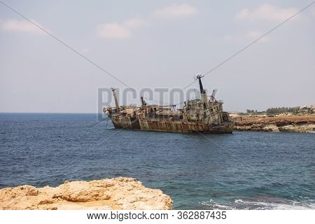 Paphos. Shipwreck. The Ship Crashed On The Coastal Rocks At The Shore Of The Mediterranean Sea. Tour