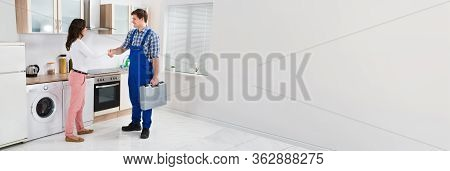 Woman Doing Hand Shake With Repair Man Or Handyman Worker