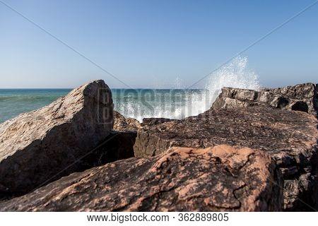 Ocean Waves Are Hitting The Rocks. Atlantic Ocean Coast With Rocks And Rocks