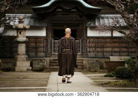 A Monk In Court Yard Of A Monastery In Kamakura, Japan.