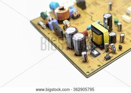 Closed Up Shot Of Broken, Damaged Integrated Circuit On Printed Circuit Board.