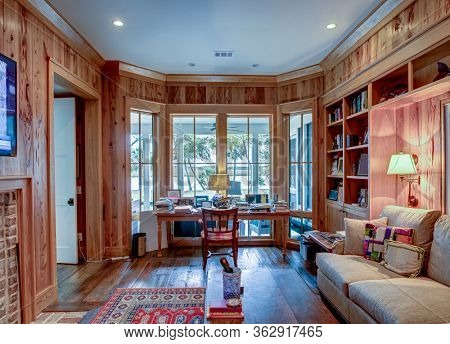 Home office workspace in beautiful home with view windows.