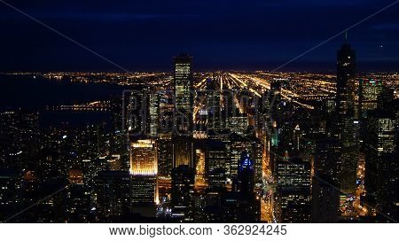 Chicago, Illinois, United States - Dec 11th, 2015: Aerial View Of Chicago Downtown At Night From Joh