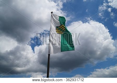 Flag Of The Free State Of Saxony. The Königstein Fortress Is A Fortress In Saxony Switzerland, Near