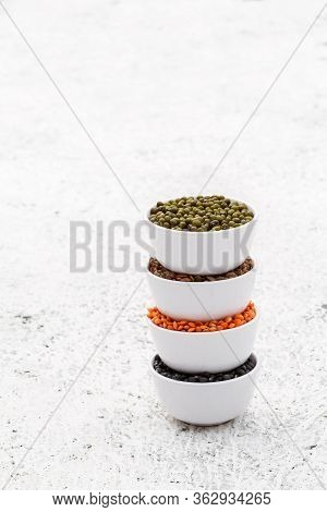Various Assortment Set Of Indian Legumes - Mung Dal, Black Orid, Red Masoor Dal, Horse Gram In White