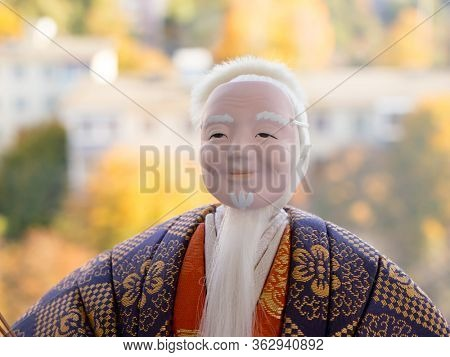 GOMEL, BELARUS - APRIL 20, 2020: The Antique Kimekomi Japanese doll old man Jo depicting a Noh play,