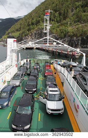 Sognefjord, Norway - July 18, 2015: People Ride The Ferry Ship Across Sognefjord, Norway. Public Tra