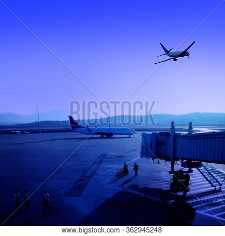Transportation image of commercial passenger airplane and departure gate at airport over sky with flying airplane