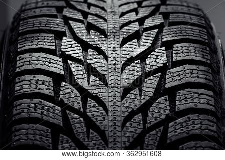 Stack Of Brand New High Performance Car Tires On Clean High-key White Studio Background. New Car Tir