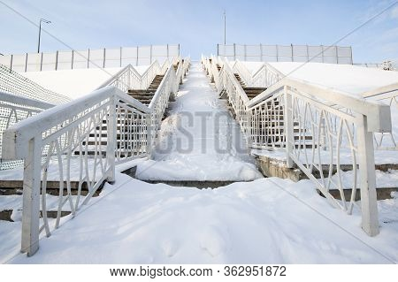 Snow-covered Steps Of A High Staircase In The City