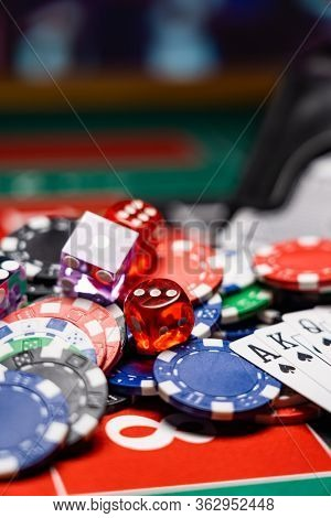 Casino set with Roulette, dice and chips on BlackJack mat