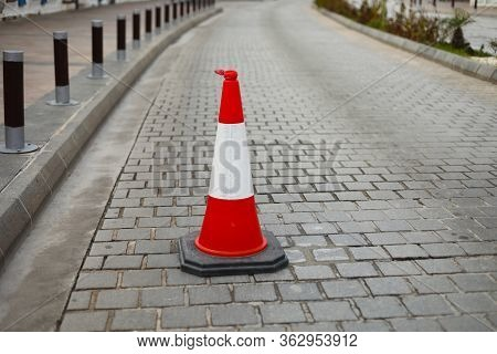 Plastic Traffic Cones On The Road To Limit Traffic Transport. Road Cone. Traffic Sign Or Indicator.