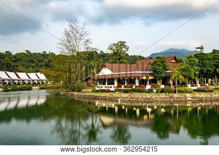 Thailand, Koh Chang, May, 2014 - Summer Wooden Bungalows Ashore Of The Pond Surrounded By A Beautifu