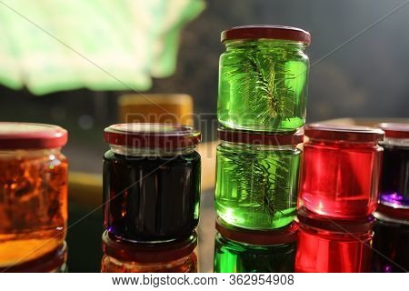 Many Jars With Honey Tinctures Of Forest Herbs, Pine Needles, Flowers And Iceland Moss. Means And Me