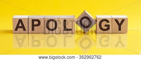 Apology - Word From Wooden Blocks With Letters, Sorry Concept, Yellow Background.