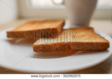 Freshly Baked Toaster Bread. Tasty Toasted Bread On Wooden Board. A Couple Of Crusty Toasts In The T