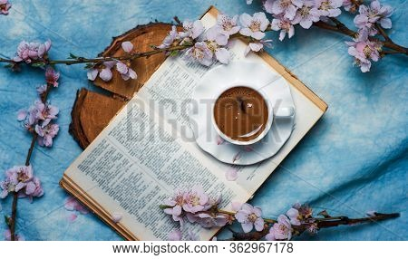 Cup Of Coffee On A Book With Cherry Blossom Branches. Spring And Sakura Abstract, Reading Leasure Ti