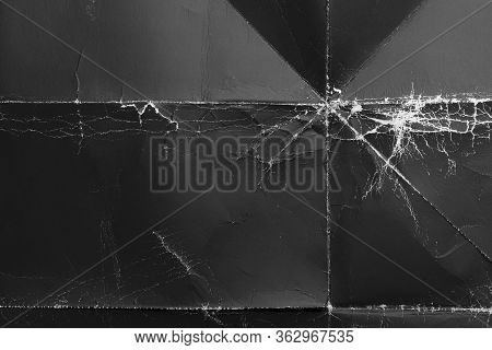 Crumpled Black Paper With Wrinkles And Rubbed Corners. Old Wrapping Dusty Cardboard. Abstract Dramat