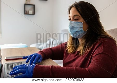 Girl Telecommuting For Confinement With Mask And Gloves