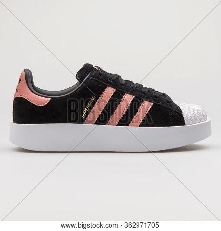 Vienna, Austria - February 14, 2018: Adidas Superstar Bold Black, Pink And White Sneaker On White Ba