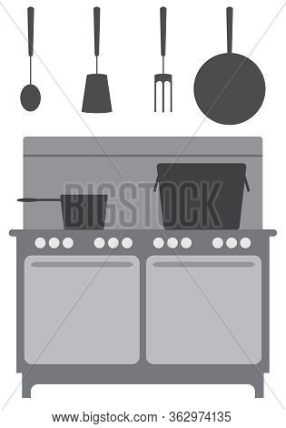 A Straight On View Of A Commercial Kitchen With Appliances And Utensils