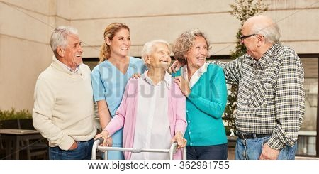 Seniors have fun together in a retirement home or nursing home