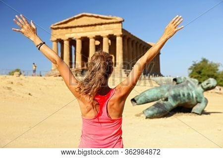 Woman tourist - Temple of Concordia, park of the Valley of the Temples in Agrigento, Sicily, Italy