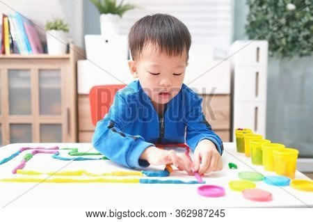 Little Asian Boy Child Having Fun Playing Colorful Modeling Clay / Play Dough At Home, Educational T