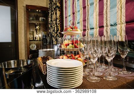 A Three-tier Modern Dish With Yellow Brass Plates And A Rod With A Ring Handle. For Desserts Or Snac